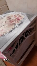 Small table hand painted with decopatch paper.lovely in any room .white and silver