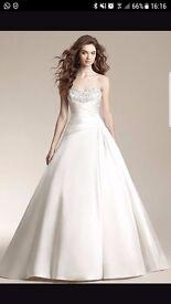 Ivory Jasmine Wedding Dress 10-12, never worn and unaltered.