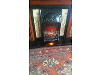 Reproduction fire surround with electric fire