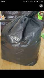 Big black bag with women clothes