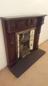 Wooden fire surround with cast iron inset and slate hearth