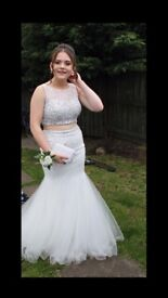 White pearl and diamond embellished two piece prom dress from Blush. Top size 8, bottom size 6.