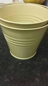 Small metal buckets