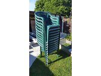 Green plastic garden chairs.