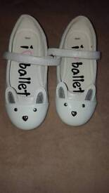 White/silver flat party shoes.