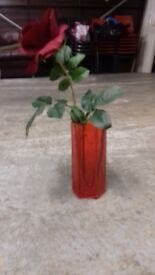 Red glass vase with free fabric rose flower.