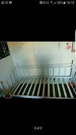 White metal bedframe