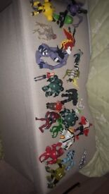 collection of ben 10 toy figures