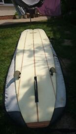 9ft2in Custard Point triple stringer surfboard with leash and bag .
