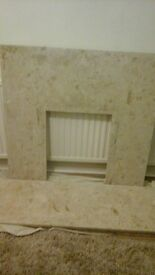 fire place, fire surround and hearth.