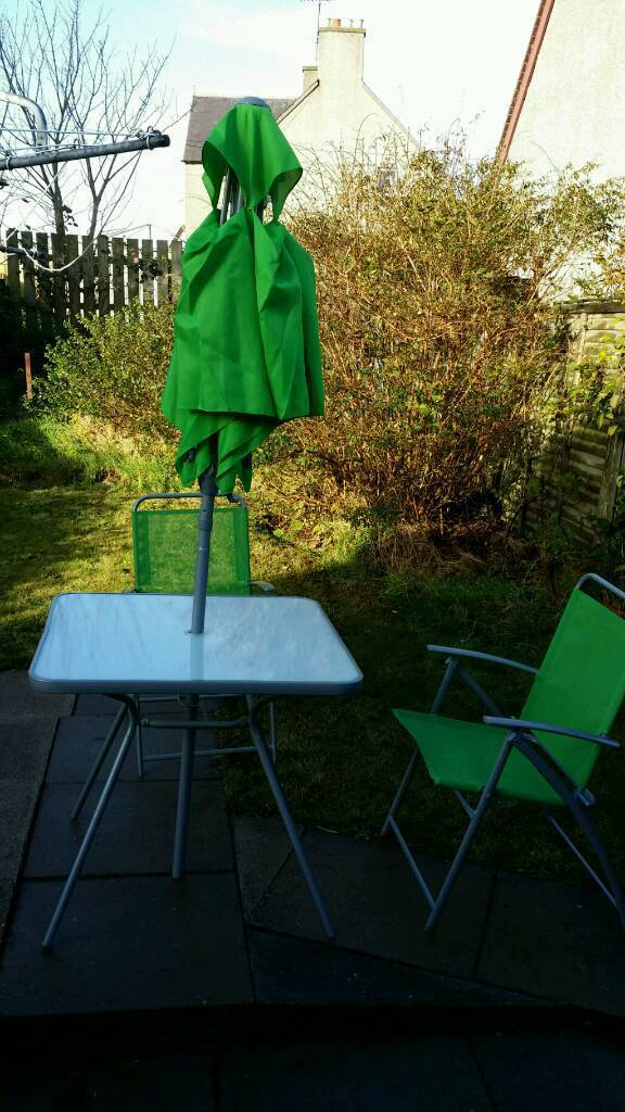 Garden table, chairs and parasol set