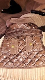 Brown lovely dog jacket . Corded collar and pockets . Bought from tk max