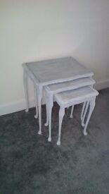 Nest of white antique tables