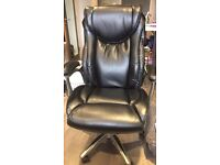 Luxurious black leather office chair with wheels
