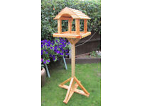 Bird feeder with house freestanding yacht varnished
