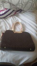 Brown and creme handbag