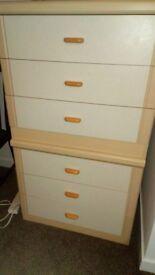 Two spacious three-drawer dressers plus three compact three-drawers