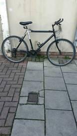 "Black Saracen Hybrid Bike, 26"" Wheels, 21 Speed, 22"" Frame"