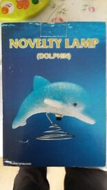 Candle stand and dolphin lamp