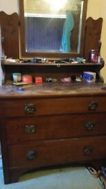 Old chest of drawers with mirror.