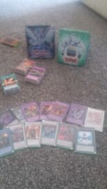 200 Yugioh cards and 4 tins including rare cards