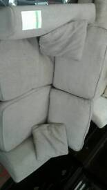It's a dark grey 2 seater sofa