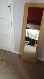 Long wood framed mirror