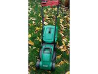 Electric rotary grass lawnmower
