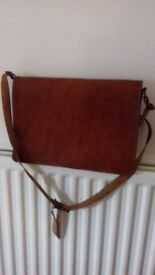 Beautifully crafted Camel leather bag; tan coloured. Suitable for male or female. Used once.
