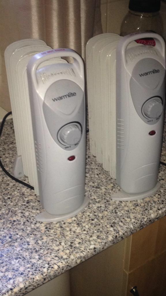 Pair of oil based radiator/heaters