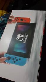 Nintendo switch brand new neon blue and red