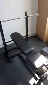 Weight bench with weight plates and dumbbells