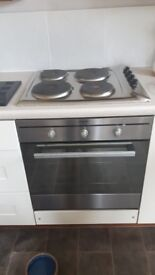 Indesit slot in oven with solid hot plate hob