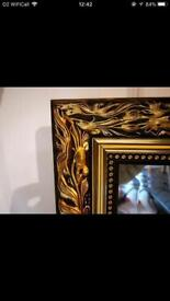 Large bevelled mirror with decorative surround
