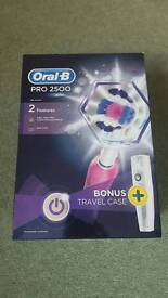 Oral B PRO 2500 electric toothbrush in pink