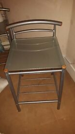 Metal frame double bed and matching tables.