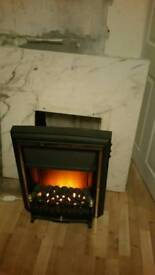 Electric fire with marble back and oak effect sorround