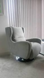 Modern grey swivel armchair