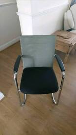 Six chrome, black and grey office chairs