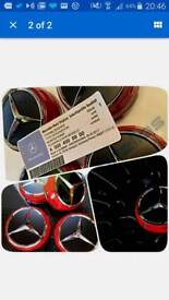 Amg mercedes centre caps black rare 15 pounds or 2 sets for 25 black an red