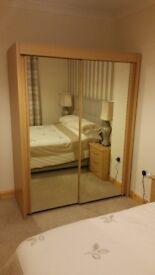 Mirrored sliding door wardrobe