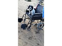 "Light folding wheelchair suitable for person 5'5"" or less"