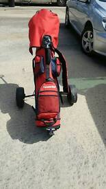 Golf clubs and trolley