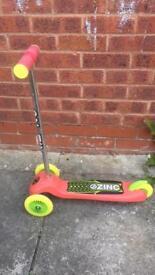 Zinc tilt and ride scooter