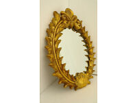 Attractive Plaster French styled and Gold in Colour Oval Mirror