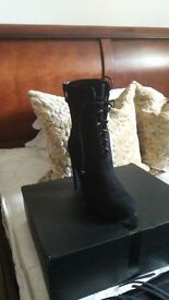 Brand new in box black boots
