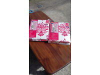 new in packets 2 pairs of red and white patterned curtains