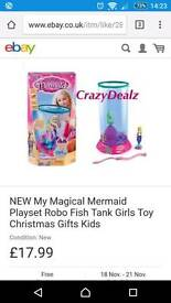 Mermaid tank with two mermaids and sea horse
