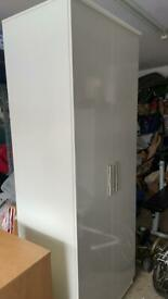 Grey and white wardrobe and bedside unit