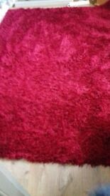 Large Red shaggy Rug. 7ft 6 x 5ft 6